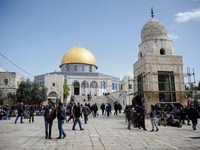 Palestinians gather to perform the Friday prayer at the Al-Aqsa Mosque Compound in Jerusalem