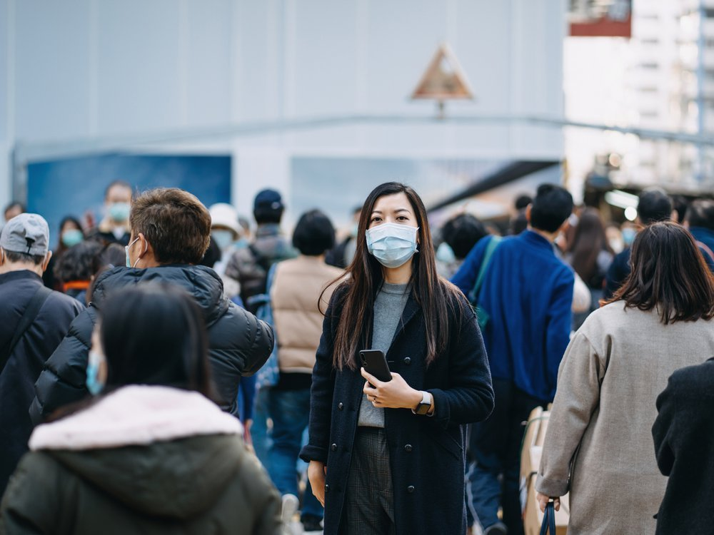 woman masked in crowd