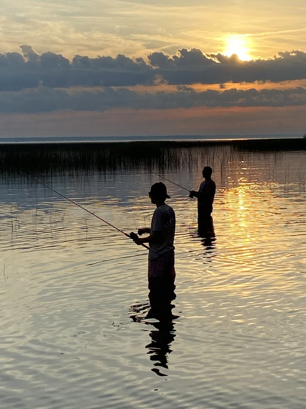 Father & Son Making Memories Fishing in Duncan Bay, Michigan thumbnail