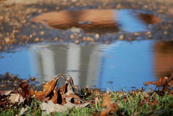Church steeple in a pothole puddle thumbnail