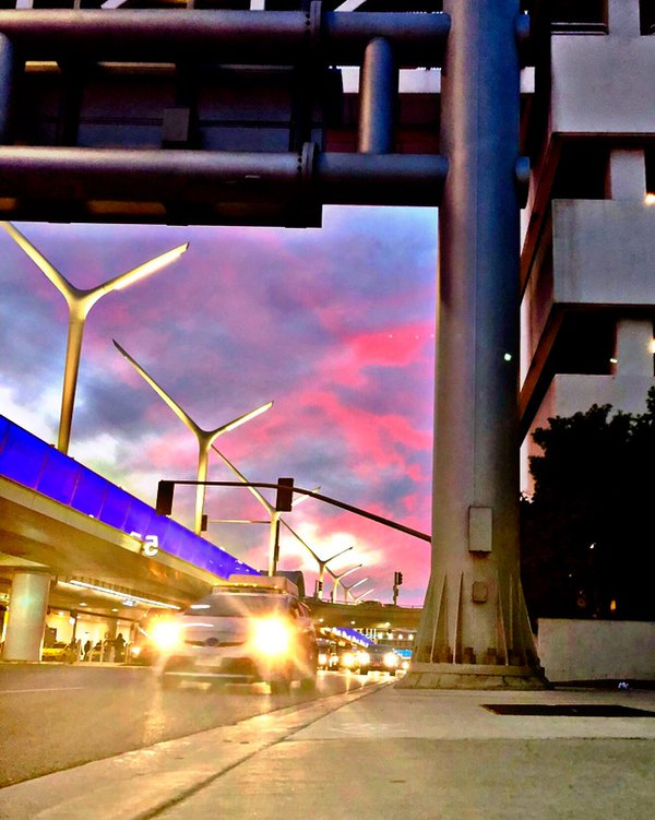 Traffic at Los Angeles International Airport during a sunset. thumbnail