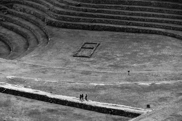 A few people walking around the Inca ruins of Moray thumbnail