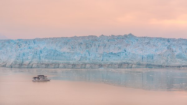 A tourist boat apeared just at the glacier, giving proportion to the size of the glacier thumbnail