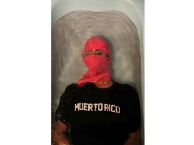 A mask and a wary eye reflects the current conditions of the global pandemic in the  2017 award-winning photograph Muerto Rico by ADÁL.