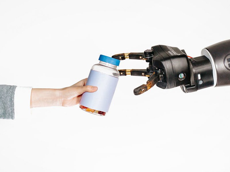 Human reaching out to robot-main.jpg