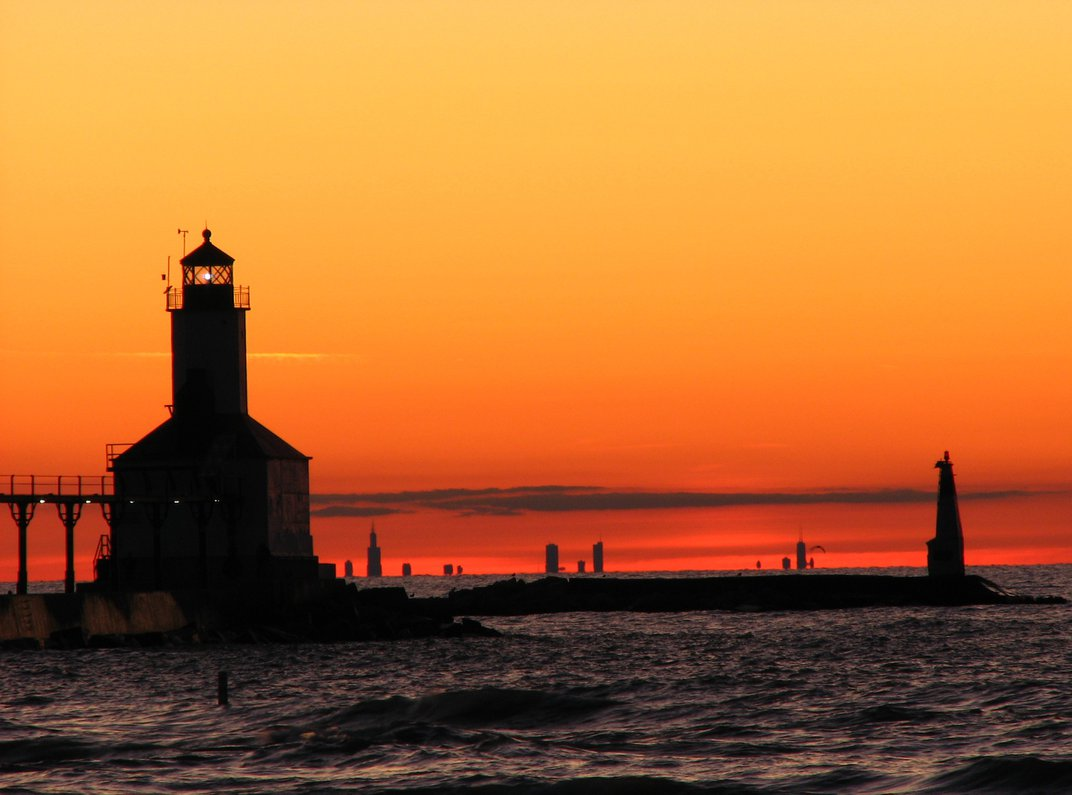 Sunset On Lake Michigan At Michigan City With View Of Lighthouse And Chicago Skyline In The Background Smithsonian Photo Contest Smithsonian Magazine