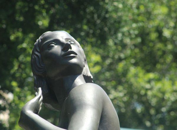 A Bronze Statue Of A Woman thumbnail