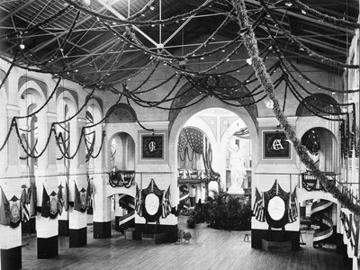 Smithsonian's Arts and Industries building decorated for James Garfield's inaugural ball, complete with string light garlands and patriotic buntings.