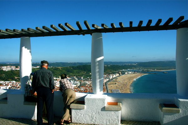 Men enjoying the view in Nazare, Portugal thumbnail