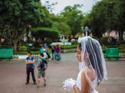 A local girl celebrates her first communion at the main church in Vilcabamba, an Ecuadorian village that retains its small-town feel despite an influx of foreigners in search of Shangri-La.
