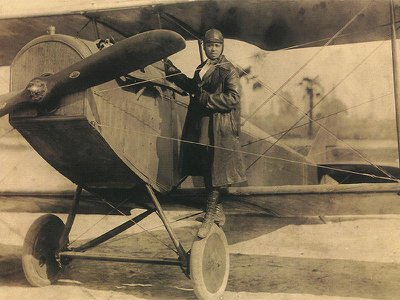 """The """"Summer Road Trip"""" uses Bessie Coleman, the first African American to earn a pilot's license, as inspiration to build a paper biplane."""