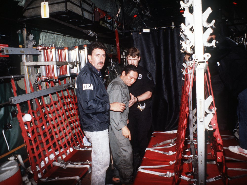 Manuel_Noriega_with_agents_from_the_U.S._DEA.jpg