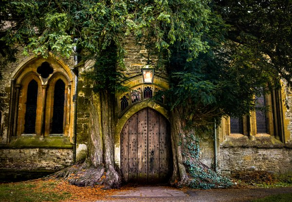 A magical looking door of St.Edward's Church in the Cotswolds thumbnail
