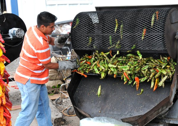 A chile vendor roasting in Hatch, New Mexico, during the annual Labor Day Chile Festival. thumbnail