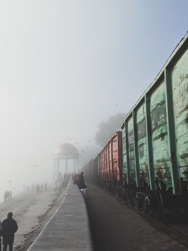 Freight train in city fog thumbnail