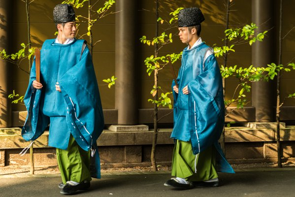 Shinto priests rushing to prayer thumbnail