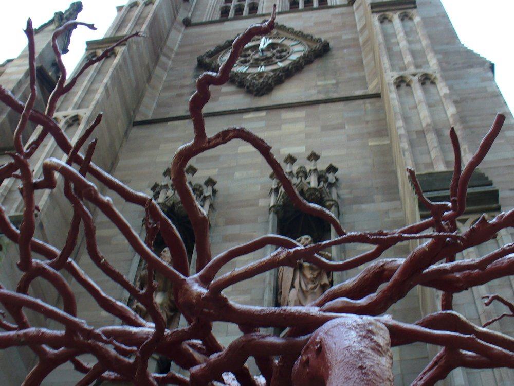 Sculptor Steve Tobin used its roots as the base for bronze sculpture