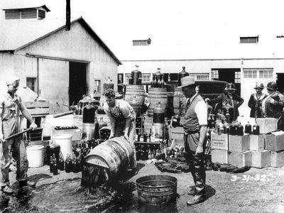 Orange County Sheriff's Department disposing of illegal alcohol, circa 1932.