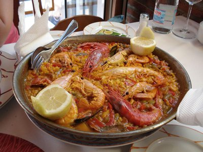 Paella, a national favorite in Spain, is a hearty dish prominently featuring two of Linford's Seven Wonders—rice and tomato. It may be seasoned with salt and chili flakes as well.