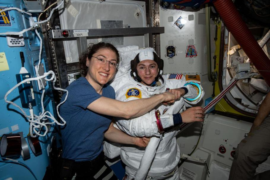 Christina Koch (left) poses for a portrait with Jessica Meir while preparing for their first spacewalk together. (Image courtesy of NASA)
