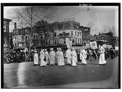 Suffragettes march, complete with cloth banners, across the intersection of Pennsylvania Ave. and 11th St. in Washington, D.C. Photo: <a href=
