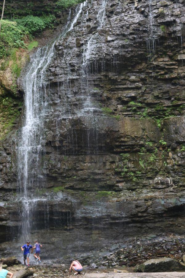 Children play at the foot of Tiffany Falls in Hamilton, Ontario. thumbnail