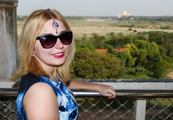 A blonde lady accessorized with Indian makeup in front of the Taj thumbnail