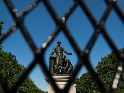 Now behind fences erected by the police, the Emancipation Memorial in Washington, D.C.'s Lincoln Park has been criticized ever since its dedication.