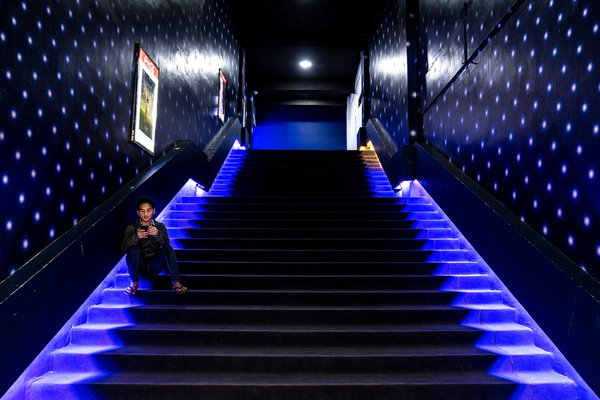 A man and the light stair at cinema thumbnail