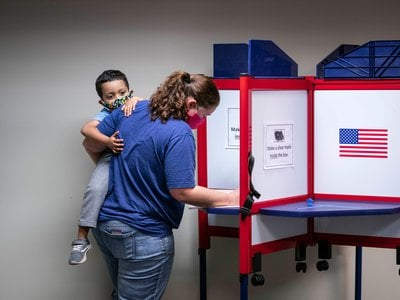 A Virginia woman votes early in the 2020 general election.