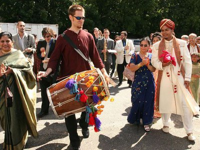 After composing and transcribing music for my wedding day, Red Baraat was born. Dave Sharma leads the baraat (wedding procession) on dhol, as I walk with my mother, family, and friends. August 27, 2005.