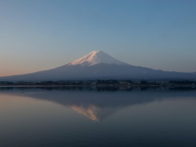 Eternally mysterious Mount Fuji, as seen from Lake  Kawaguchiko, remains a powerful force in Japanese culture and a must-do hike for truth-seekers despite the crowds and the looming threat of eruption.