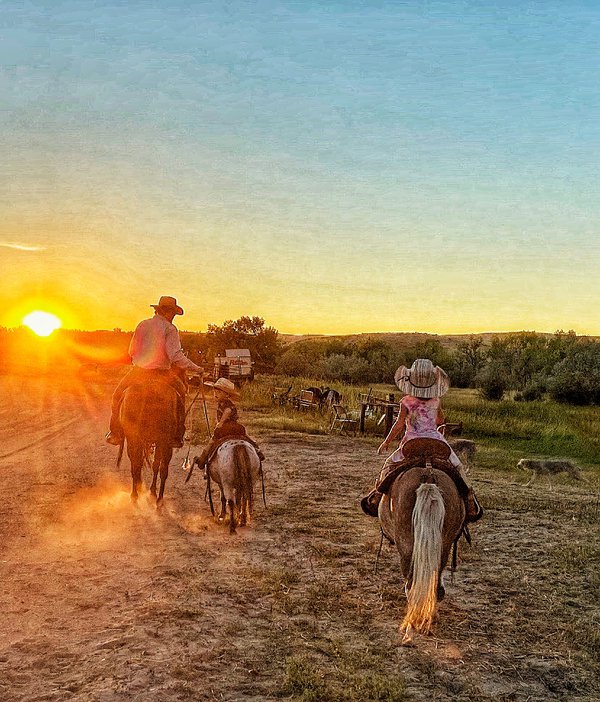 Riding off into the sunset on a beautiful Wyoming evening thumbnail