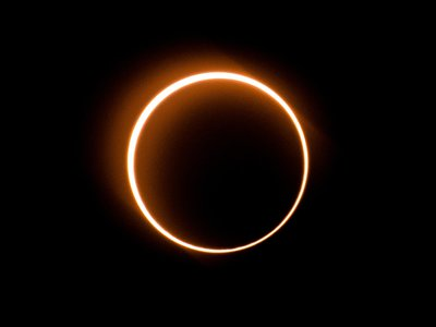 """The moon moves in front of the sun in a rare """"ring of fire"""" solar eclipse as seen from Tanjung Piai, Malaysia on December 26, 2019."""