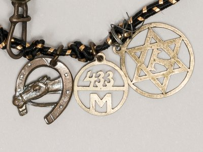 These charms are among the 20 found on a bracelet donated by Holocaust survivor Greta Perlman