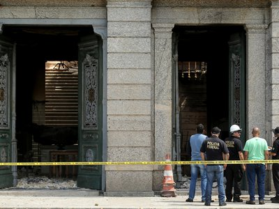 Federal police forensic specialists investigate the cause of the fire that tore through Brazil's National Museum in Rio de Janeiro.