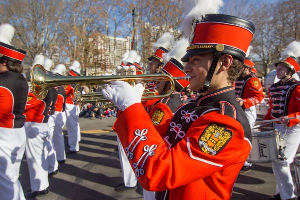 A member of a marching band plays his trumpet during the Thanksgiving Day Parade in Philadelphia this year. thumbnail