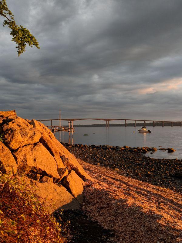 Golden glow on the rocky shore thumbnail