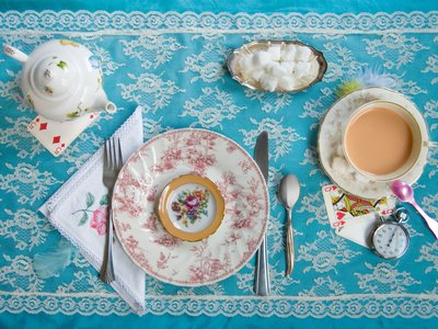 """A tea party. Inspired by Lewis Carroll's Alice's Adventures in Wonderland: """"Alice looked all round the table, but there was nothing on it but tea."""""""