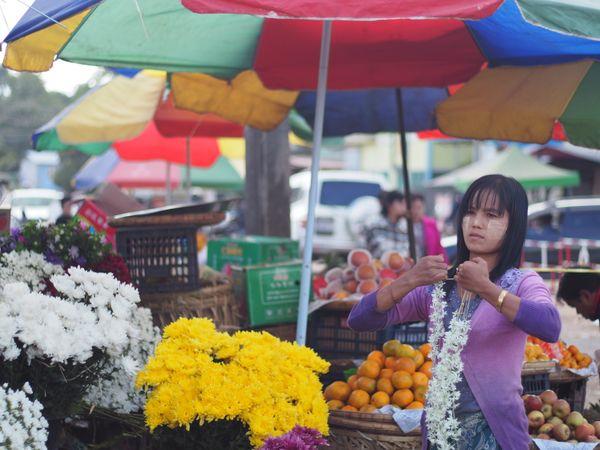 Woman selling flowers in Pyin Oo Lwin, Myanmar thumbnail