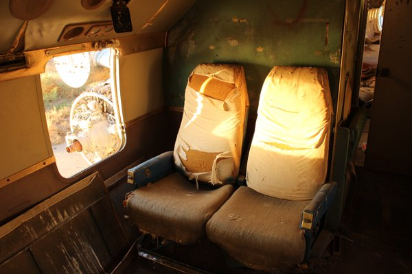 Worn Seats on an Abandoned Plane thumbnail