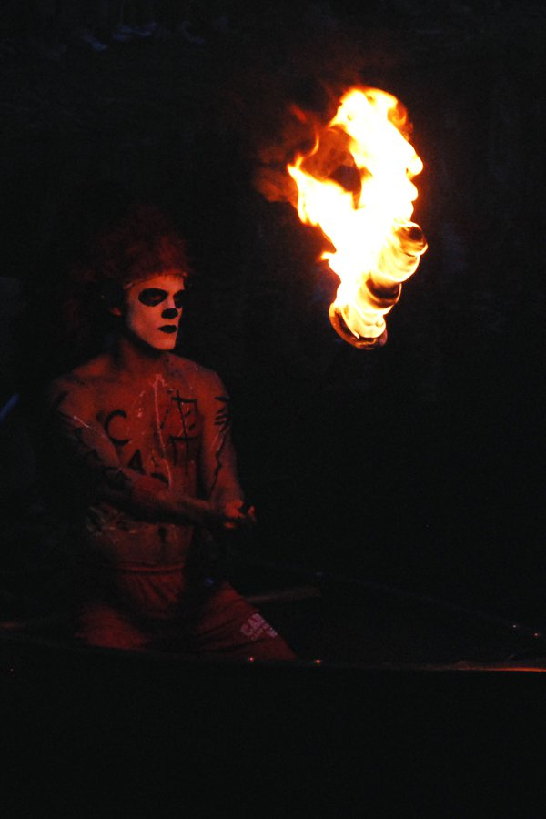 The Caddo Chief carries his torch during tribal initiation for kids at  a summer camp. thumbnail