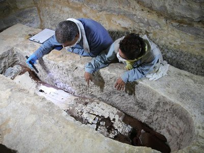 Researchers examine a seven-and-a-half-ton limestone sarcophagus in a mummification workshop that dates back to ancient Egypt.
