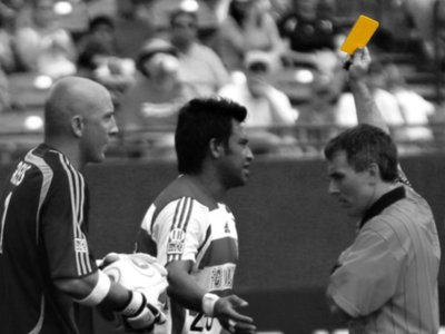 The yellow card is an elegant design solution that has been adopted by several sports.