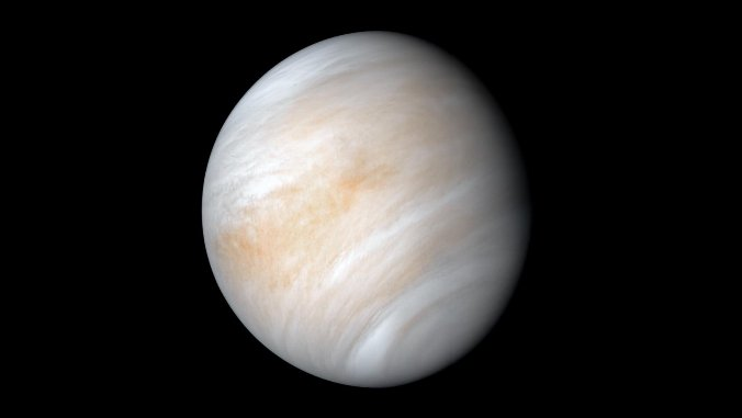 Venus, a ball of swirling light brown, white and grey, framed against a jet black background