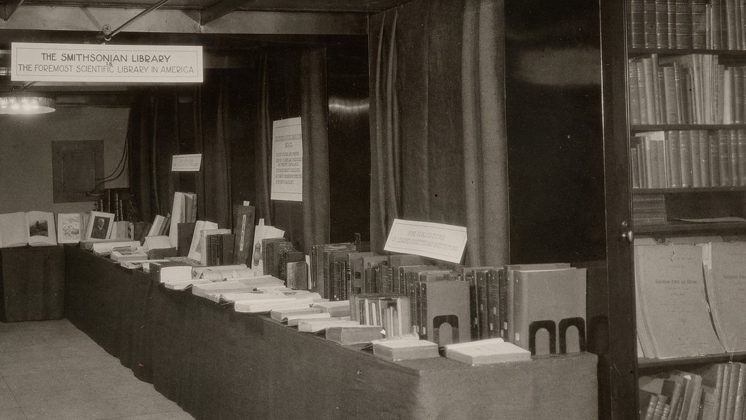 Black and white photograph of library display with books on table.
