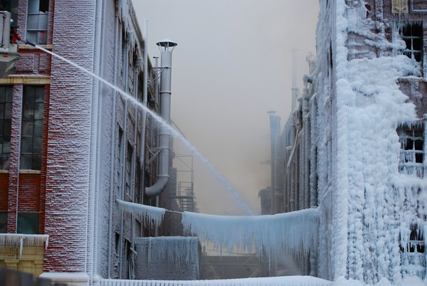 Firemen putting out a fire in Chicago. The water froze and turned the building into an ice castle. thumbnail
