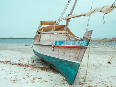 """For centuries, wooden boats called """"dhows"""" have sailed Lamu's shores, transforming the far-flung island into an important port city."""