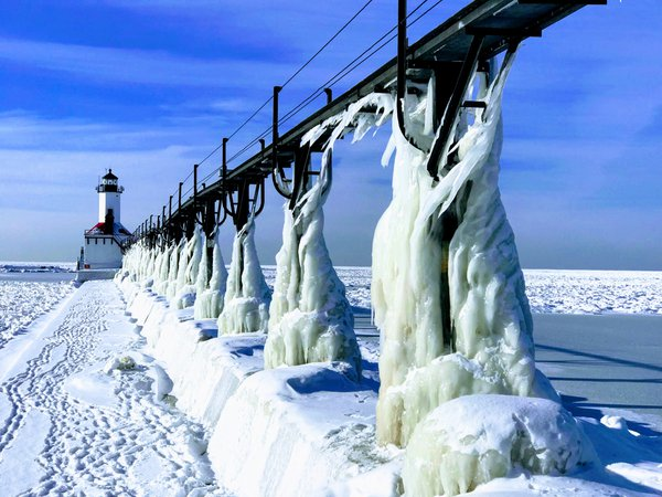 Lake Michigan lighthouse and pier coated in ice thumbnail