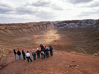 Visitors take a guided tour of the Barringer Meteorite Crater in northern Arizona.